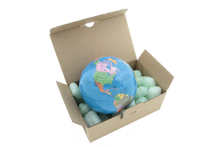 terrestrial globe on a carton box isolated on white background photo