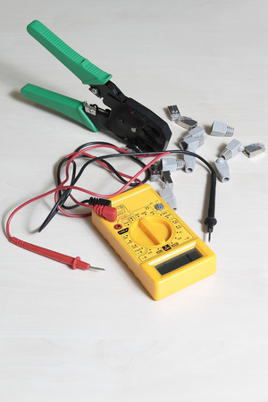 handtool: multimeter tester, press pliers and RJ45 connectors Stock Photo