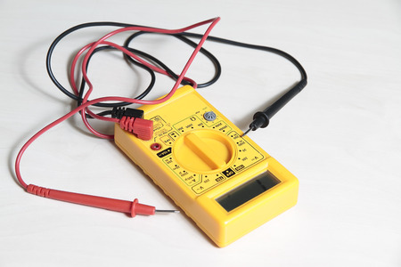 handtool: yellow multimeter tester to test electric equipment