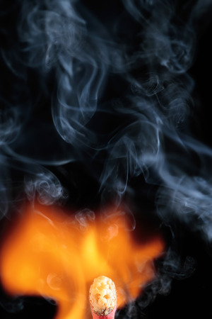 flame like: head of a matchstick between the flame and the smoke that draws a face like a ghost