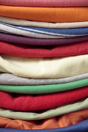 used clothes: background of used clothes of differents colors