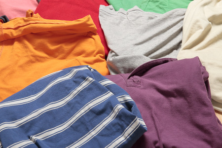 used clothes: picture as background of colorful used clothes