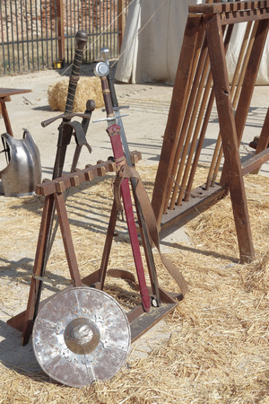 espadas medievales: medieval swords and shield on a recreation of a medieval scene