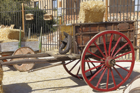 old wood farm wagon: antique farm wagon in a outdoor exposition Stock Photo
