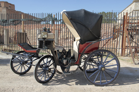 old wood farm wagon: antique horse carriage in a outdoor exposition Stock Photo