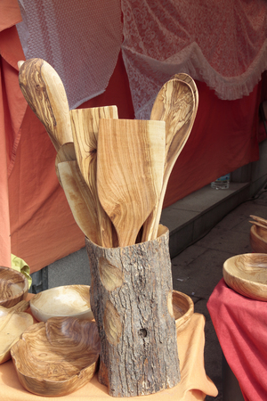 forefront: forefront of several cookware carved in olive wood