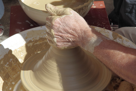 forefront: forefront of the hands of a potter doing ceramic