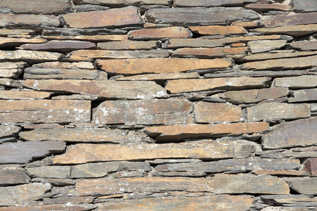 construction materials: wall of slate bricks. Slate is typical of the villages of black architecture in the province of Guadalajara-Spain