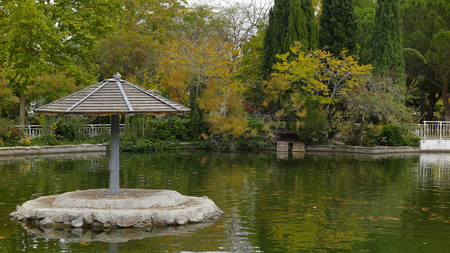recreational area: umbrella in the pond of a recreational area in the city of Coslada in the province of Madrid-Spain