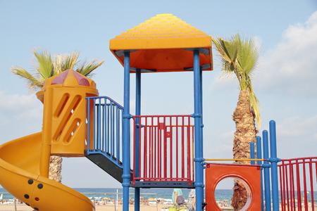 toboggan: detail of a orange toboggan in a recreation area at the beach