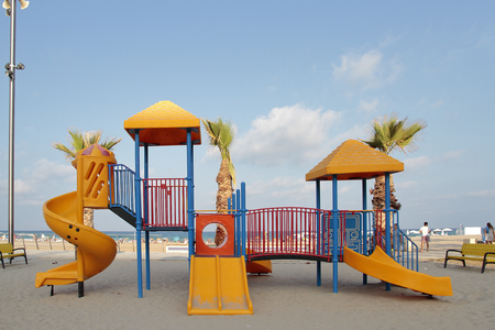 toboggan: front view of a orange toboggan in a recreation area at the beach