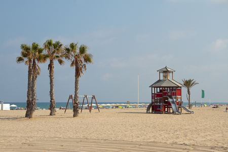 toboggan: beach landscape with a toboggan house shaped