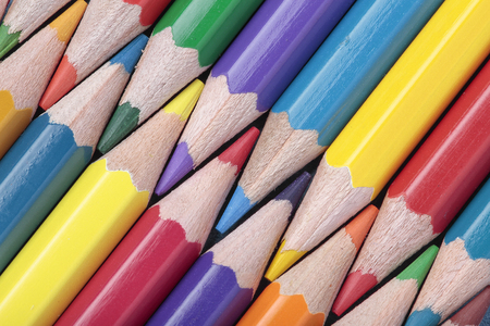 interleaved: foreground of some crayons interleaved on a diagonal composition