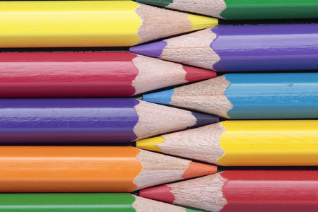interleaved: foreground of some crayons interleaved on a horizontal composition Stock Photo
