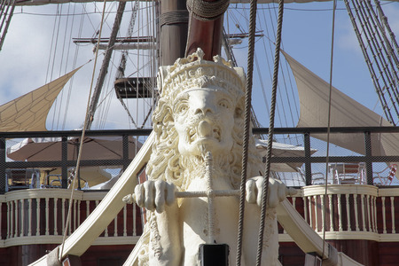 ship bow: foreground of the figurehead lion shaped in an ancient warship