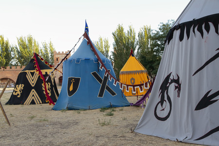 outdoor scene with some tents in the recreation of a medieval military camp Stock Photo