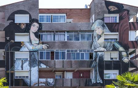 murillo: TORREJON DE ARDOZ, MADRID, SPAIN - JULY 15: picture named majas en el balcon of the famous spanish painter Francisco de Goya. replica made by the painter Manuel Ojeda on the facade of a building of the city. picture taken on july 1, 2015 in Torrejon de  Editorial