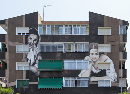 murillo: TORREJON DE ARDOZ, MADRID, SPAIN - JULY 15: picture named mujeres en la ventana of the famous spanish painter Bartolome Esteban Murillo. replica made by the painter Manuel Ojeda on the facade of a building of the city. picture taken on july 1, 2015 in T Editorial