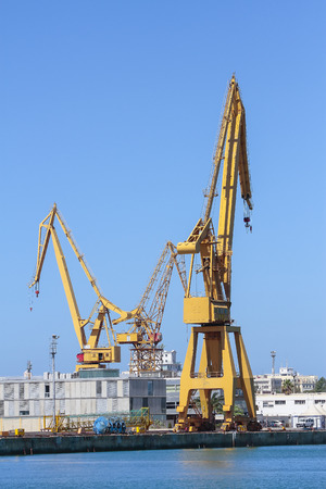 vertical view of port cranes in the harbor of cadiz, spain Stock Photo