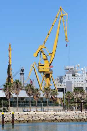 arms trade: vertical view of port cranes in the harbour of cadiz, spain
