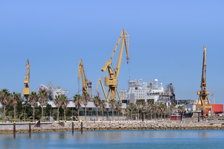 arms trade: panoramic view of port cranes in the harbour of cadiz, spain Stock Photo