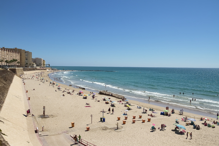 horizontal view of santa maria del mar beach in the city of cadiz, spain 写真素材