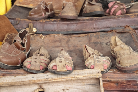stand with old leather shoes and sandals handmade in a traditional way