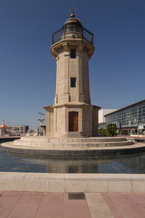 vertical view of the lighthouse in the port of castellon de la plana in the province of castellon, valencian community, spain on a summer day