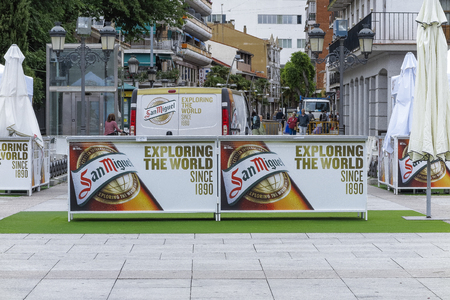 TORREJON DE ARDOZ, MADRID, SPAIN - MAY 25, 2018: stands of san miguel beer with the claim exploring the world during a celebration in the city of torrejon de ardoz