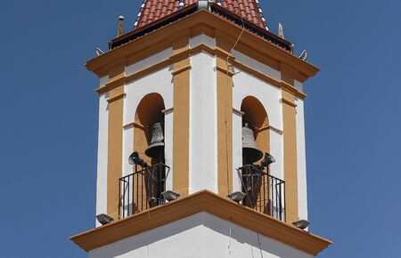 detail in horizontal view of bell tower of the immaculate conception church in the spanish municipality of Sierra de Yeguas
