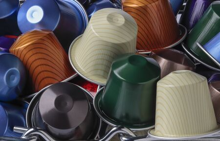 horizontal view of some colored coffee espresso capsules piled up Banque d'images