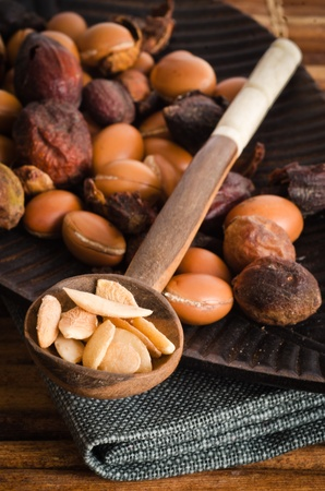 without: Argan fruits with shell and without Stock Photo