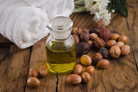Argan oil with fruits in a natural atmosphere photo