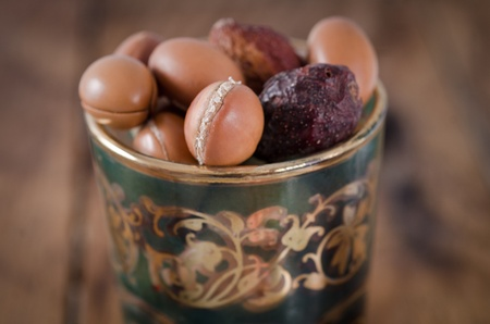 Close up of Argan fruits in a typical Moroccan glass Stock Photo