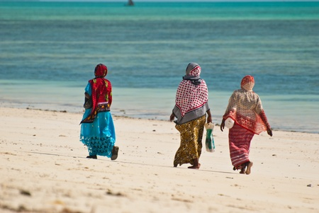Women walking on the beach in colorful dresses