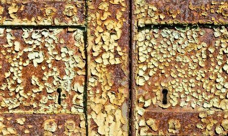 scraped: the keyhole of a rusty and scraped door