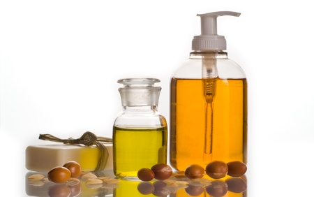 Argan oil with fruits and cosmetic products photo