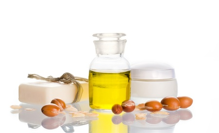 Argan oil used in cosmetic products with argan nuts. Argan nuts come from Morocco Stock Photo - 9484346
