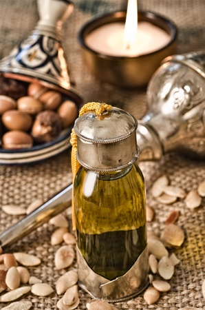 Still life of argan oil with fruits and moroccan objects photo