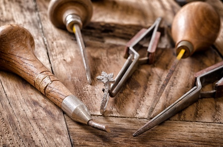 jeweler: Still life of goldsmiths tools with diamonds ring