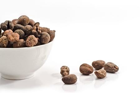 Cup full of shea nuts on white background Zdjęcie Seryjne
