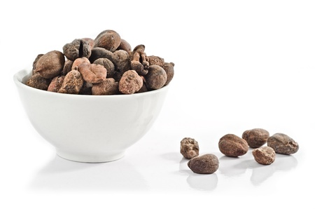 Cup full of shea nuts on white background Stock Photo