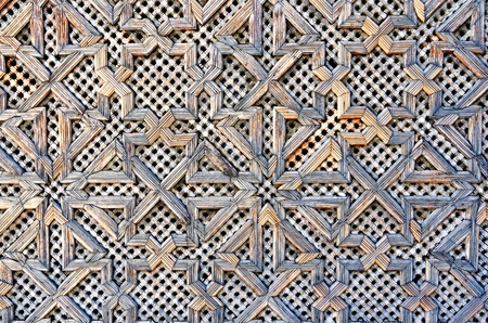 Pattern of a wooden gate of a mosque in Fez, Morocco photo