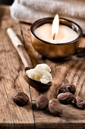 Still life of shea nuts and butter in a spoon.