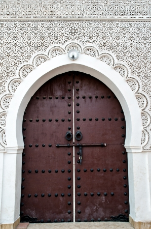 ornated: Door of a Moroccan Mosque with floral and geometric decorations
