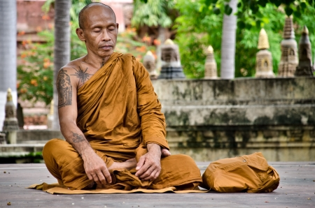 enlightening: unidentified monk meditates under a body tree on August 9, 2012  In Bodgahya Lord Buddha was enlightened under a Body tree and now this is a place of worship  Editorial
