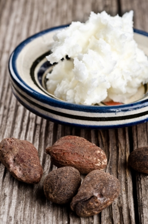 Still life of shea butter and nuts, used for cosmetic products and skincare