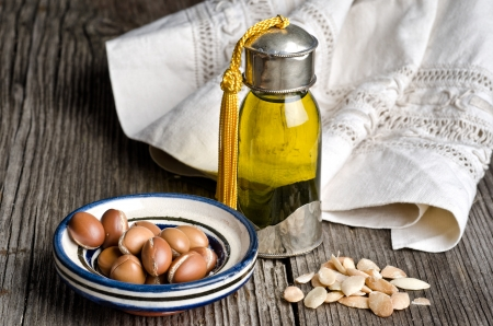 oil seed: Bottle of argan oil and argan fruit. Argan oil is used for skincare products.