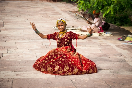 richly: Jodhpur, India-August 16, 2008: unidentified richly dressed dancer welcomes people at the entrance of Jaswant Thada, in Jodhpur. Jaswant Thada is a royal cenothaph built for Maharaja Jaswant Singh II