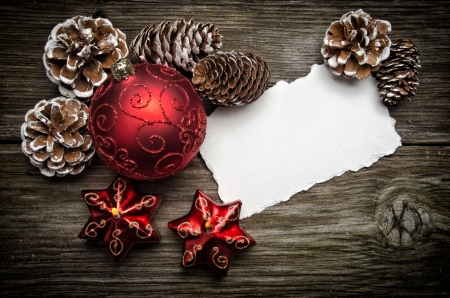 christmas cards: Greeting card for Christmas with red ball and candles on wooden top
